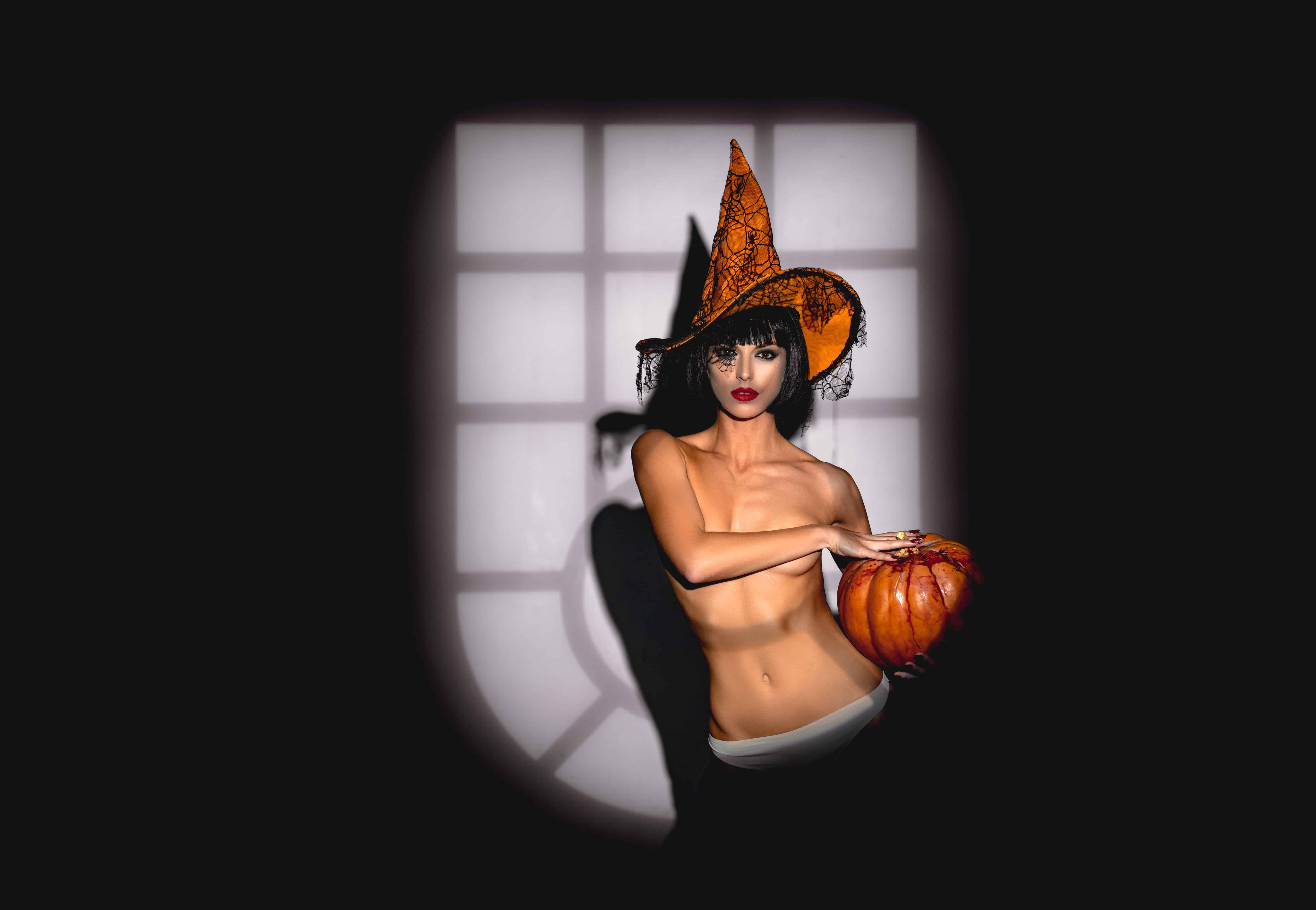 Sexy Girl holding a Halloween Pumpkin